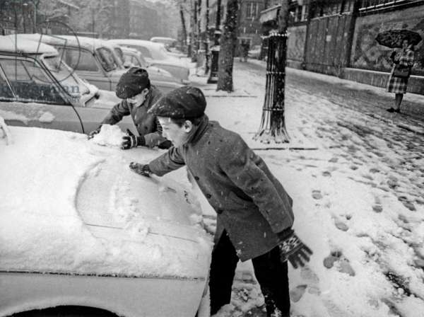 Winter in Paris, December 6, 1969 : Children Taking Snow on The Cars Probably For A Snowball Fight (b/w photo)