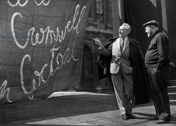 Jean Cocteau and Director Jean Serge June 25, 1956, Paris (b/w photo)