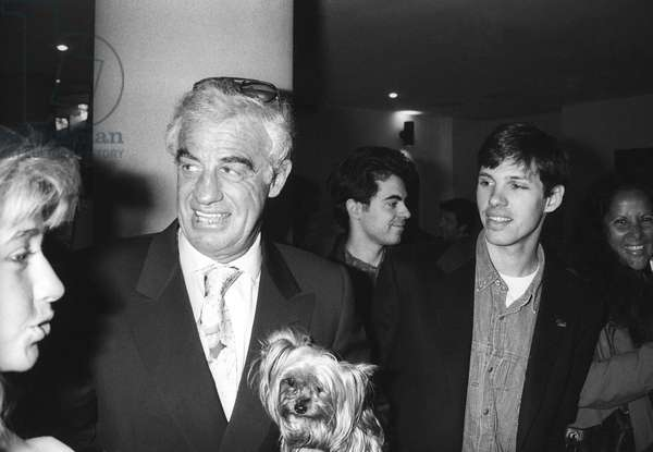 French actor Jean Paul Belmondo and his son French racing driver Paul Belmondo at the display of Voiture3000 in Paris on April 8, 1991 (b/w photo)