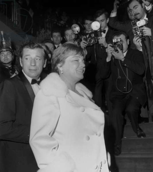"""Simone Signoret and Yves Montand Arriving at Premiere of Film """"Grand Prix"""" at Empire Theatre in Paris on March 10, 1967 (b/w photo)"""