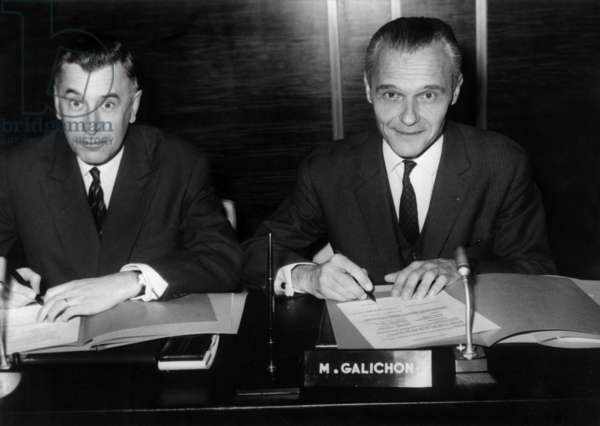 Jean Ravanel Commissioner for Tourism (Left) And Mr Georges Galichon President of Air France Signing the Cooperation Agreement November 23, 1967 At Air France Headquarters (b/w photo)