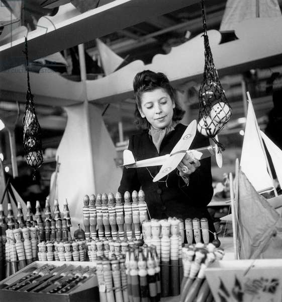 Salesperson at Toys Section at Christmas December 1St, 1945 (b/w photo)