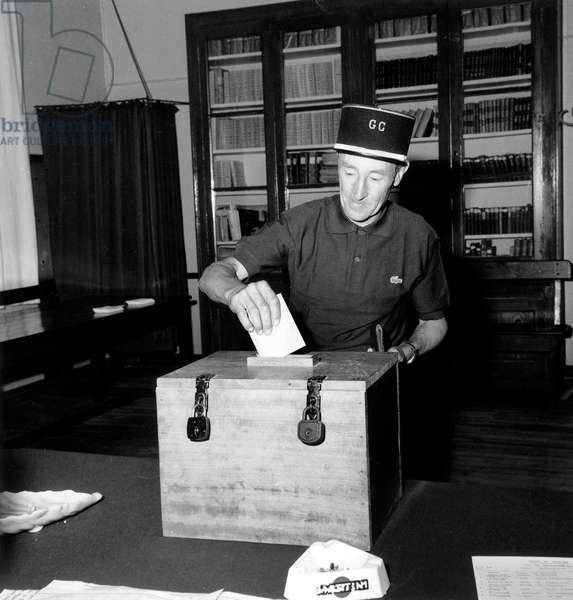 Presidential Elections 2Nd Turn : Raymond Fontaine French Local Policeman in Orvilliers Putting Voting Paper in The Ballot Box June 15, 1969 (Georges Pompidou Will Be Elected President) (b/w photo)