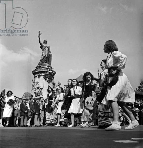 July 14, 1947, Paris (Place De La Republique) : Young Women Parading (b/w photo)