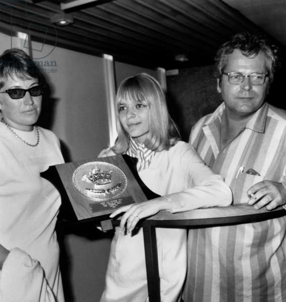 France Gall With her Parents at Paris Airport Back From Tour in Japan June 23, 1966 (She Is Holding The Song Prize She Received Over There) (b/w photo)