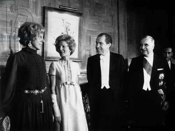 French President Pompidou in Usa on February 25, 1970 at Diner at French Embassy in Washington : Mrs Claude Pompidou, Mrs Patricia Nixon, American President Richard Nixon, French President Georges Pompidou (b/w photo)