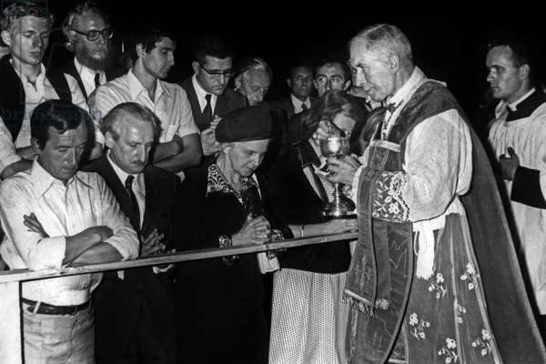 French Bishop Lefebvre Administering Communion in Lille (France) on August 30, 1976 Contrary To Exhortations of Pope Paulvi Who Institute A New Mass (b/w photo)