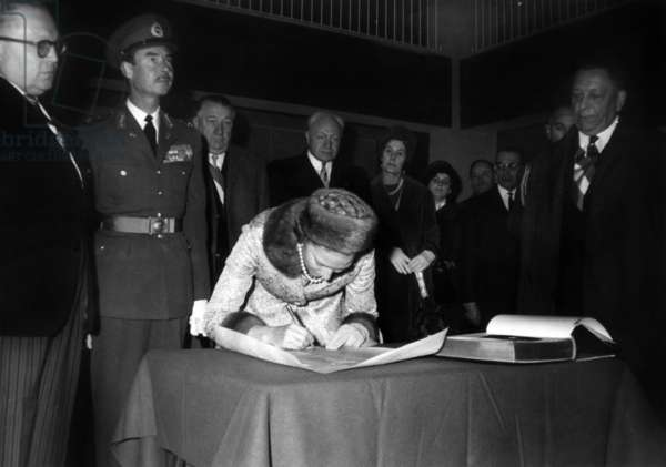 On November 14, 1964, abdication of the Grand Duchess Charlotte of Luxembourg (signing) in favour of her son Grand Duke Jean of Luxembourg (uniform) under look of  prince Felix de Bourbon (Felice di Borbone, l) (b/w photo)