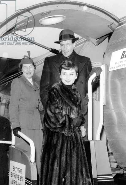 Audrey Hepburn and Husband Mel Ferrer at Paris Airport February 21, 1955 (b/w photo)