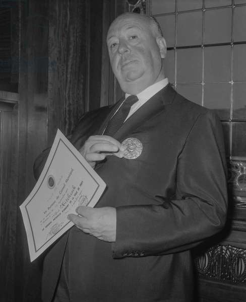 Alfred Hitchcock has received the City of Paris medal, October 4, 1960 (b/w photo)