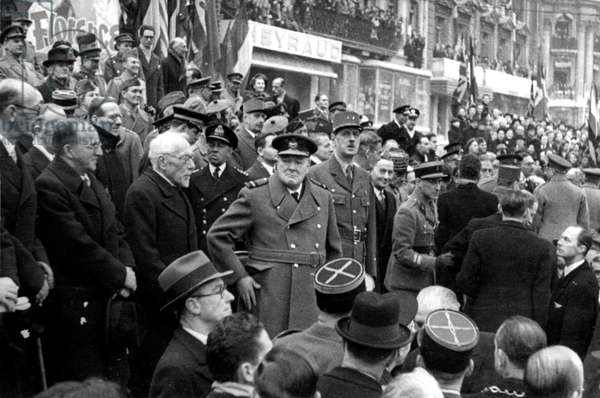 Winston Churchill,, English Prime Minister, General Charles De Gaulle and Anthony Eden Attending A Parade in Paris on November 11, 1944 (b/w photo)