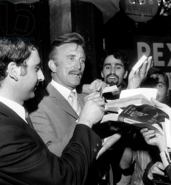 Kirk Douglas Signing Autographs in Parisian Movie Theatre Rex August 29, 1967 at Presentation of Film The War Wagon (b/w photo)
