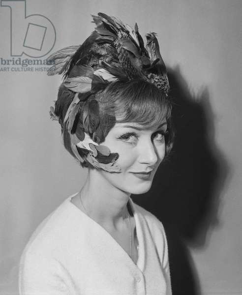 Hairstyle by Molinario with feathers, September 21, 1960 (b/w photo)