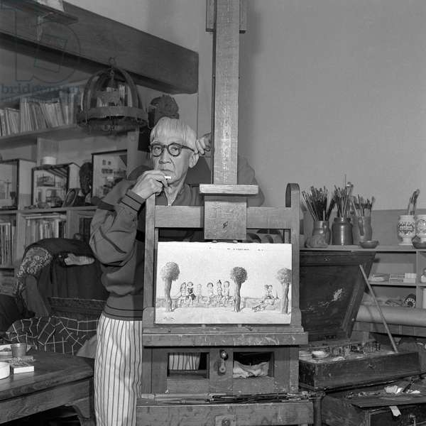 The Painter Tsuguharu Foujita (1886-1968) In front of One Of His Works In His Workshop Rue Campagne Premiere In The Montparnasse Quarter In Paris Around 1957