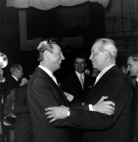 Charles Trenet Congratulated By Maurice Chevalier For his 20 Years Career, January 22, 1958 (b/w photo)
