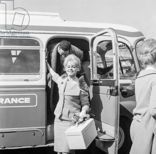 French actress Brigitte Bardot leaving for London, here at Orly airport, Paris, April 9, 1959 F3(b/w photo)