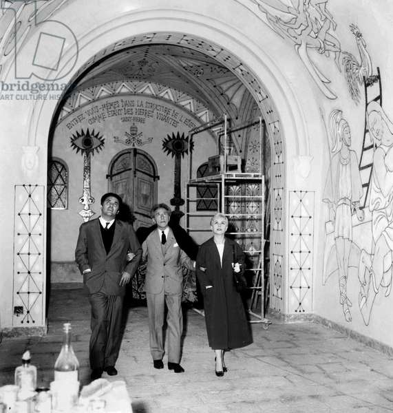Federico Fellini and Giulietta Masina Visiting The Chapel Saint Peter in Villefranche-Sur-Mer (France) Decorated By Jean Cocteau May 13, 1957 during Cannes Film Festival (b/w photo)
