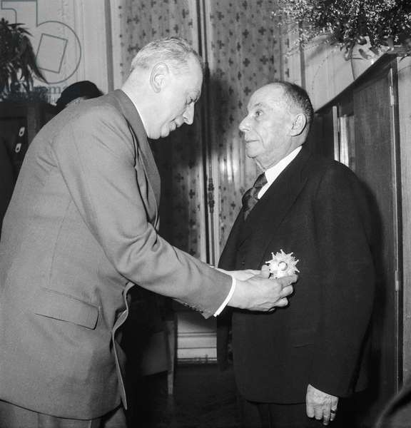 Georges Brouardel, President of the French Red Cross, receiving from French Health Minister Pierre Schneiter the Legion of Honour, Paris, Janaury 29, 1951 (b/w photo)