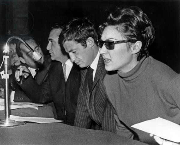 French Actors Jean-Paul Belmondo and Nadine Alari during Meeting of French Actors' Trade Union December 6, 1964 (b/w photo)