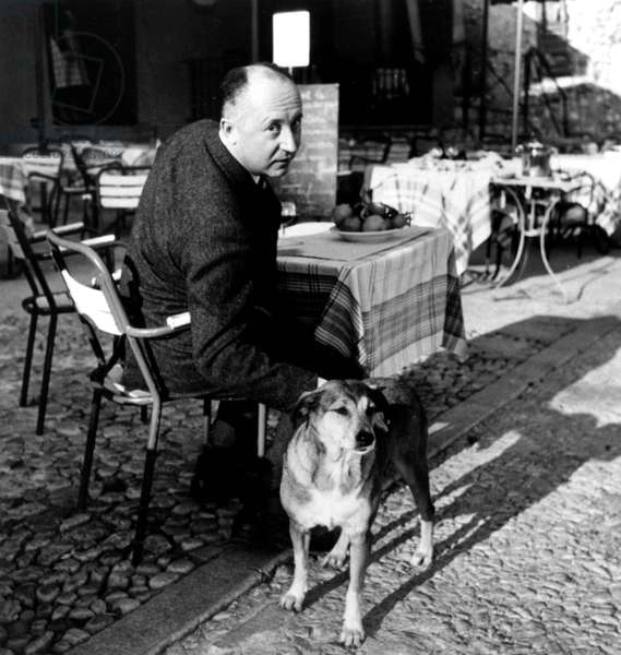 French Couturier Christian Dior (1905-1957) Having A Lunch in Aix-En-Provence With his Dog Bobby in October 1957 (b/w photo)