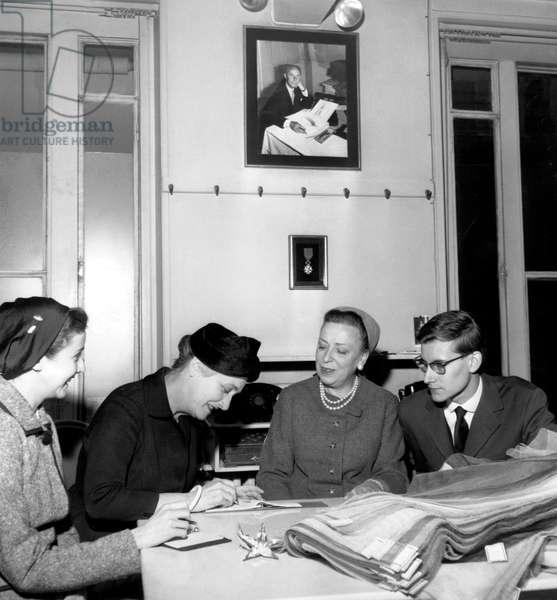 Yves Saint Laurent With Mrs De Tallance, Mrs Duguet, Mrs Raymonde November 16, 1957 (b/w photo)