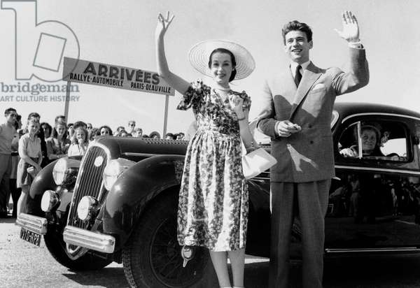 Marcelle Derrien and Yves Montand at Paris-Deauville Car Race July 26, 1947 (b/w photo)