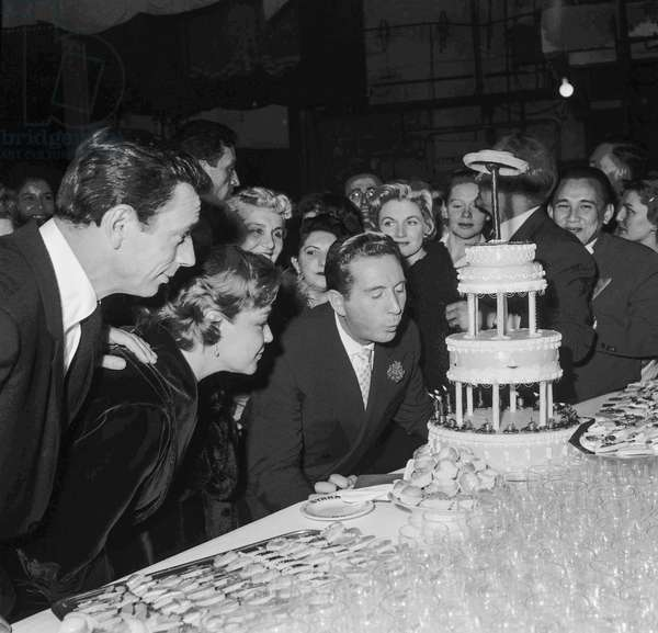 Charles Trenet celebrating his career, at the Alhambra in Paris, January 22, 1958 : Yves Montand, Simone Signoret, Charles Trenet, Philippe Clay (b/w photo)