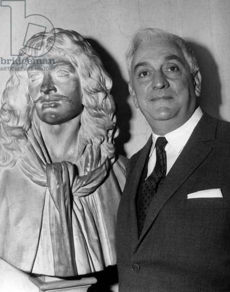 Jean Paul Moulinot, Fact Desormais Part Of La Comedie Francaise. This is in front of Le Bust De Moliere. October 25, 1966 (b/w photo)