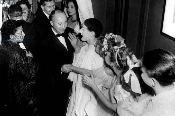 Christian Dior Saluting Actors Jean Louis Barrault and Madeleine Renaud November 11, 1952 (b/w photo)