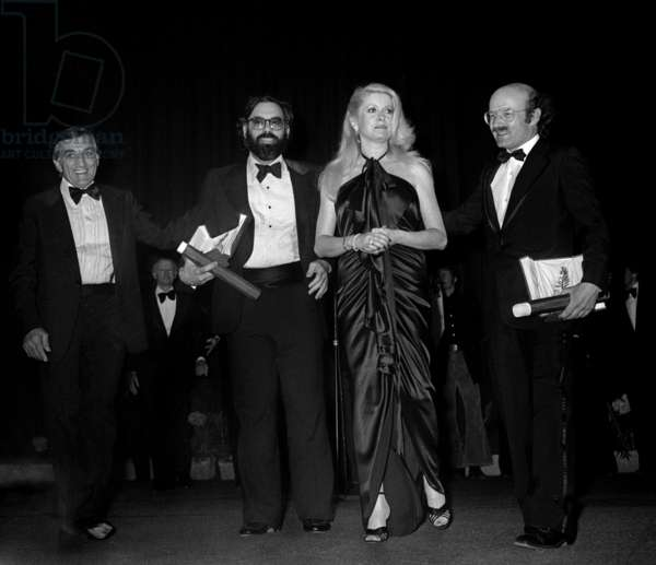 Lino Ventura and Catherine Deneuve Giving The Golden Palm To Volker Schlondorff For Film The Tin Drum and To Francis Ford Coppola For Film Apocalypse Now at Cannes Film Festival May 28, 1979 (b/w photo)