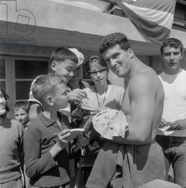 French athlet Pierre Allard signing autographs, Fontainebleau, August 4, 1960 (b/w photo)