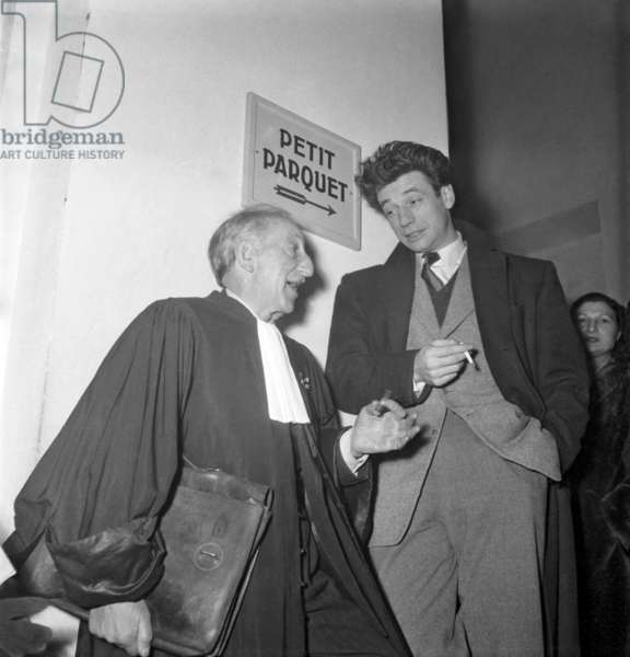 French Actor Yves Montand and his Lawyer Levy Ouleman (Warner Trial) Paris, November 30, 1948 (b/w photo)