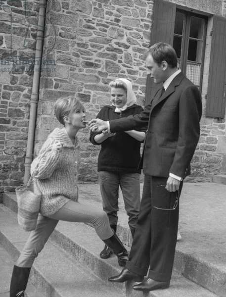 "Dany Saval and Jean Louis Trintignant on set of film ""Le chateau du mystere"" in Missillac, France, September 9, 1960 (b/w photo)"