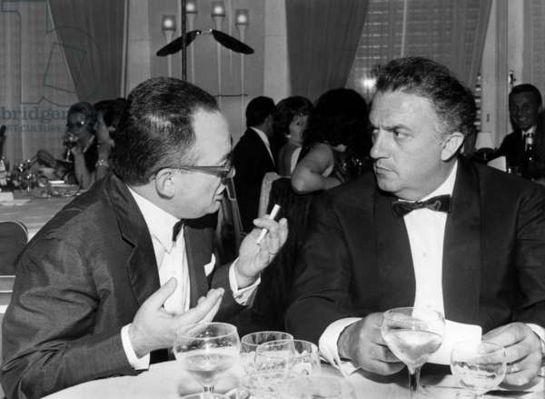 Director Federico Fellini With Producer Dino De Laurentis at Restaurant, June 7, 1963 (b/w photo)