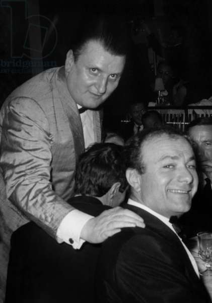 """Jean Mejean And Fernand Raynaud (Right) During the Inauguration Evening of the New Formula du Cabaret """"Le Carnal"""" Les Champs-Elysees Which Mejean became the Host and Director on May 5, 1966. (b/w photo)"""