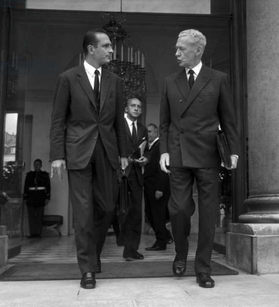 French Prime Minister Maurice Couve De Murville (R) and Jacques Chirac Estate Secretary of Economy and Finances Leaving Elysee Palace After Ministers Counsil September 25, 1968 (b/w photo)