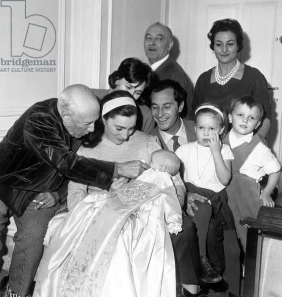 Pablo Picasso With Is Goddaughter on The Knee of Jacqueline Roque Under Look of Luis Miguel Dominguin and his Wife Lucia Bose With Their 2 1St Children January 12, 1961 (b/w photo)