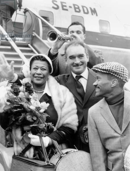 Jazz Singer Ella Fitzgerald Greeted By Eddie Barclay, Michelattenoux and his Musicians April 30, 1957 at Paris Airport (b/w photo)