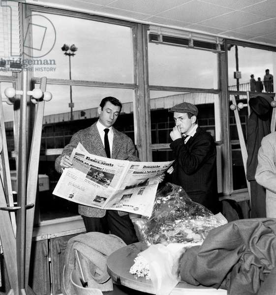 Singer Yves Montand With Guitarist Henri Crolla Before Going To Moscow December 16, 1956 (b/w photo)