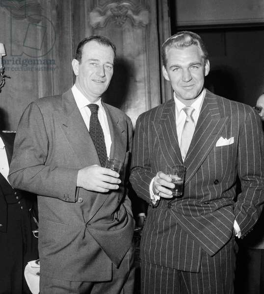 Reception given in honour of John Wayne, Paris, March 5, 1951 : John Wayne and Forest Picker (b/w photo)