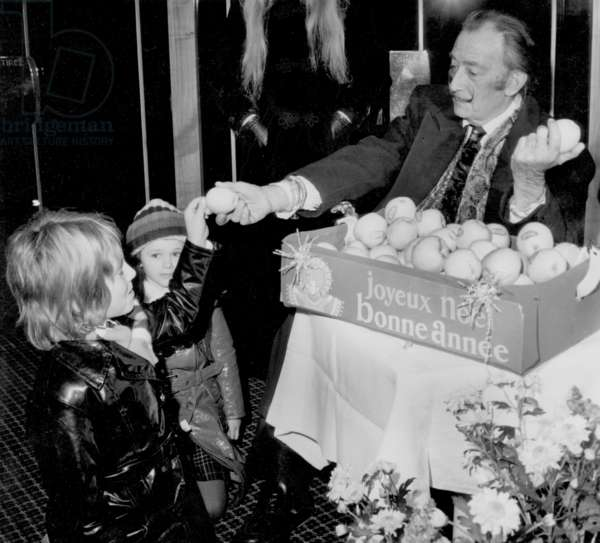 Salvador Dali Is Giving Apples To Members of The Audience in A Cinema For The Campaign