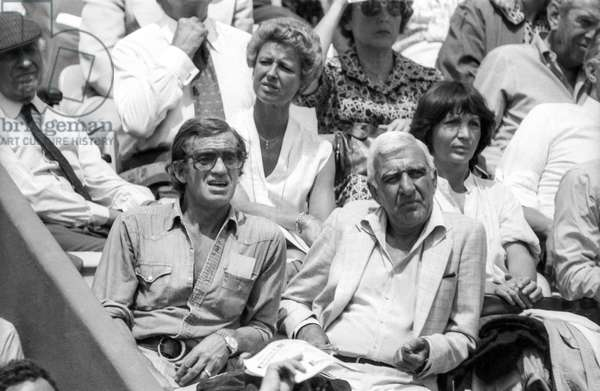 French actors Jean Paul Belmondo and Charles Gerard (right) attending Roland Garros tennis tournament on June 3, 1980 (b/w photo)