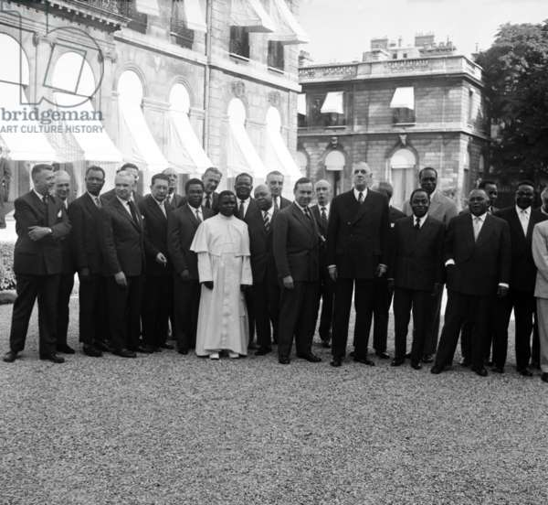 French President Charles De Gaulle Receiving at Elysee in Paris African Heads of State September 11, 1959 : Robert Buron (Far L), Roger Frey, Fulbert Youlou President of Congo (White), Michel Debre (French Prime Minister), Charles De Gaulle and Felix Houphouet Boigny (b/w photo)