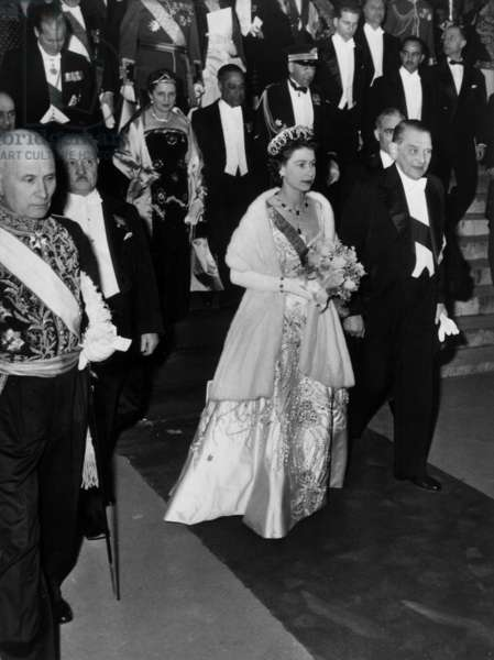 After a representation in the Opera of Paris, the Wueen Elisabeth II of England and the French President Rene Coty, at middle distance , l-r De la Chauviniere, Le Troquer, le Prince Philip d'Angleterre and Madam Monnerville, april 10, 1957(b/w photo)