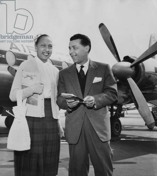 Josephine Baker and Jo Bouillon, her Second Husband, at Orly Airport on July 3, 1958 (b/w photo)