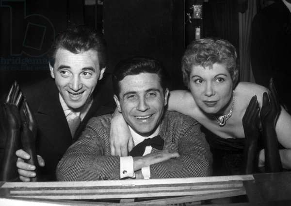 Charles Aznavour and Jacqueline Francois Has Won A Prize (Music Hall Prize, Bronze Hand) here With Gilbert Becaud (C) February 21, 1957 (b/w photo)