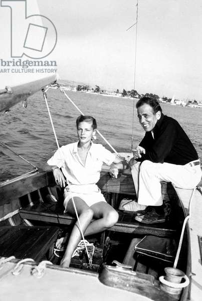"Lauren Bacall and Humphrey Bogart on The Sailboat ""Santana"" C. 1946 (b/w photo)"