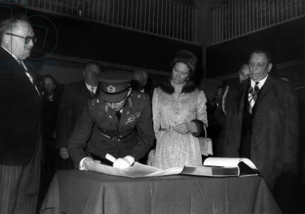 On November 14, 1964, abdication of the Grand Duchess Charlotte of Luxembourg (c) in favour of her son Grand Duke Jean of Luxembourg (signing) under look of  prince Felix de Bourbon (Felice di Borbone, l) (b/w photo)