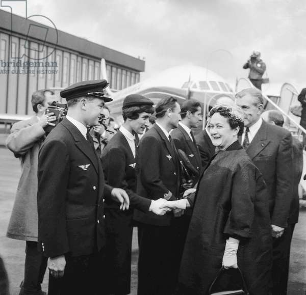 """Christening of the 1st Air France Caravelle (nammed """"Lorraine"""") at Orly airport, Paris, March 24, 1959 : Mrs Yvonne de Gaulle shaking hands with staff members, on r is Max Hymans (b/w photo)"""