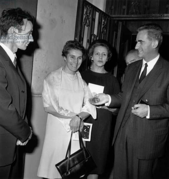 Pierre Joliot-Curie (Son of Irene and Frederic Joliot Curie), Miss Langevin, Eve Curie (Daughter Ofpierre and Mariecurie) and Alain Peyrefitte For Exhibition About Pierer Andmariecurie) in Paris on October 24, 1967 (b/w photo)